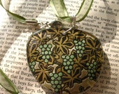 Reserved for Jen- Eyeglass pendant - Art Nouveau currants
