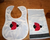 Red and black ladybug burp cloth and bib set