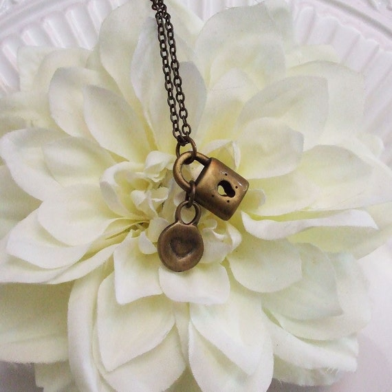 tiny heart and lock necklace . bronze