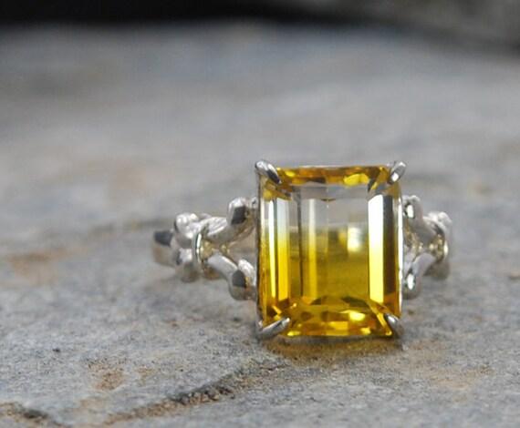 Citrine Cocktail right hand ring, emerald cut, bi color stone, fleur de lis detail