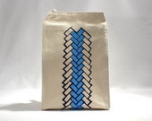 geometric pattern lunch bag brick pattern recycled cotton canvas peacock blue with dark violet water based ink