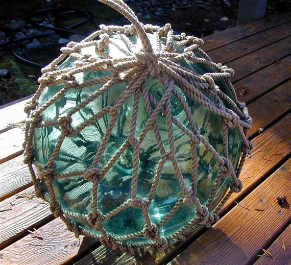 Glass fishing vintage float 12 inch net marked japanese for Vintage ocean decor