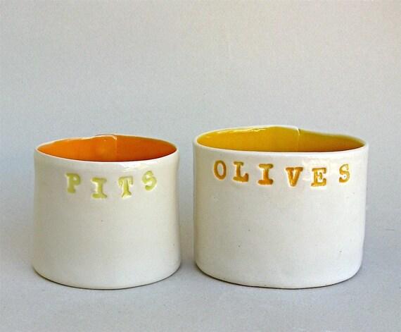 olives and pits  ...   hand built porcelain vessels