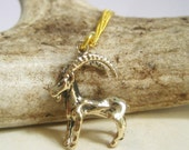 Capricorn charm necklace. Goat charm. Deer charm. Ram charm. 17 inch gold plated chain.