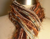 The Vixen Fringe Scarf in Shades of Taupe, Brown, Rust, Copper, Sea Blue, Burnt Orange and Cream