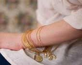 Bracelets for Good Luck - Golden Dozen light Bangles.