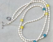 Fresh water pearl necklace with colored ball and diamonds