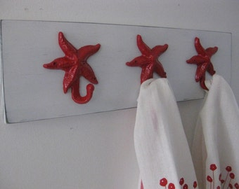 starfish hooks on distressed wood, cottage chic, Shabby chic ,whitewashed wood, available in 26 colors