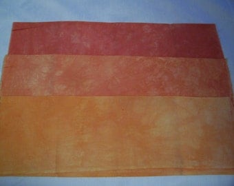 Hand dyed fabric,  orange golds
