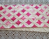 One UFO Cathedral Windows Quilt. Bed Scarf.  Approx 60 x 14. Shades of Hot Pink and Muslin. PIF