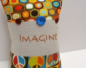 """hand-embroidered pillow- """"Imagine""""- with peace signs- rust, forest, amber, green, blue, imagine peace"""