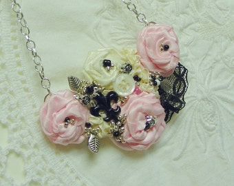 French Fleur de Lis and Rosettes on a pretty bib necklace with black lace, pink roses, beads and more