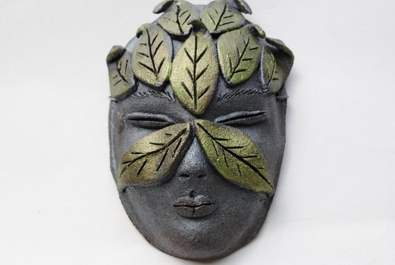 ceramic mask sculpture leaf face garden wall art  woodland mask