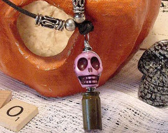 Amethyst Crystal in 9mm Bullet Casing Topped with Purple Magnasite Skull Necklace 11J140