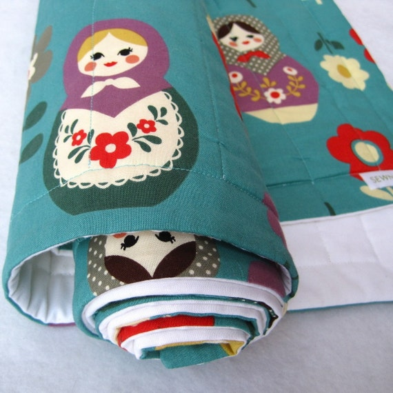 eco friendly baby quilt with matryoshka dolls on organic turquoise blue