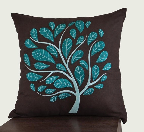 teal and brown decorative pillows