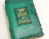 The Book of Secrets. Green leather journal.