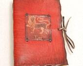 Red LEO Horoscope Leather Journal.