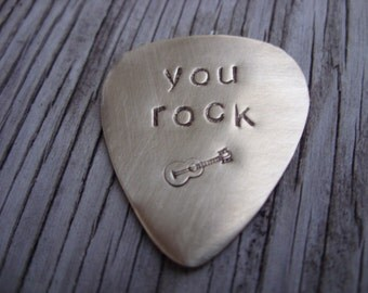 Hand stamped brass guitar pick- custom gift for a cool musician