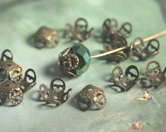 Antiqued brass iron filigree beads caps with a 4 petal design