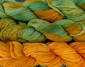 Pure wool yarn worsted weight , hand dyed green and gold ocher