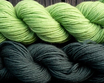 Pure wool sock yarn sport weight,  apple green and hunter green, 2 skeins, 3.5 oz