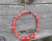 Crimson red beaded hoop earrings