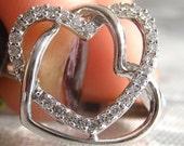 18 Karat White Gold Diamond Hearts Ring