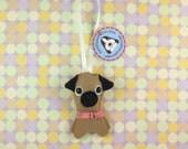 Tan Pug Hanging Phlat Puppy