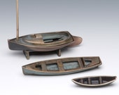 Bronze Cat Boat (top boat in photo), Sand Cast Cape Cod Sailing