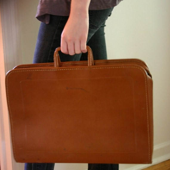 Great cowhide brief case any man or woman...or laptop.... would love.