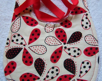 Baby Bib and Burp cloth set. Red, white, and black floral. Great for your little one or as a baby shower gift. Super absorbent.