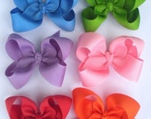 You pick 5 boutique bows your choice of color
