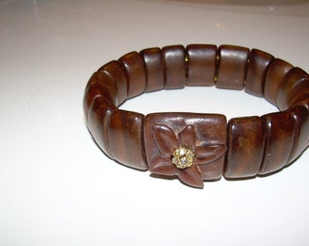 Milo wood stretch bracelet with carved flower and crystal