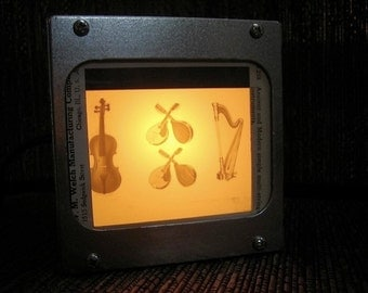 MUSCIAL INSTRUMENTS - Vintage magic lantern glass slide light box