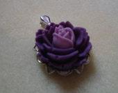 Pretty vintage inspired purple flower pendant