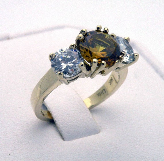 Citrine and cubic zirconia ring in 14K yellow gold