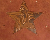 Rustic western leather pillow with star inset of embossed leather