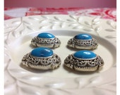 Turquoise colored two hole slider beads