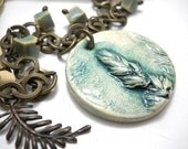 Teal Ceramic Antiqued Brass Necklace,  Feather Pendant, Cream Suede Lace, Elaine Ray Ceramic Beads