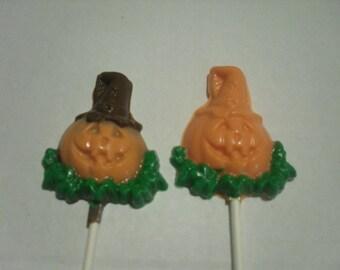 A dozen Halloween Jack o lantern pops