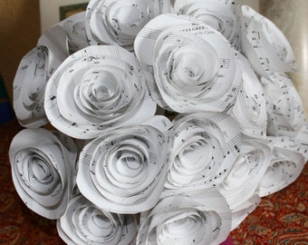 Wedding Bouquet,centerpice I can make  these with the sheet music from your wedding song Music .