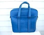 Vintage oversized cerulean blue vinyl Samsonite carry on hand bag