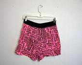 vintage neon pink and black 80s shorts