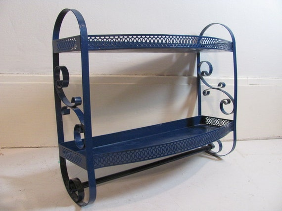 Vintage blue metal cut out two layered wall shelf with towel rack