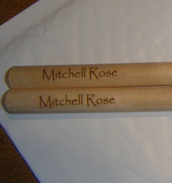 Personalized laser engraved 2B drumsticks and a Display Rack for a single pair of sticks