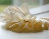 cotton ruffle necklace in cream. antique bronze chain.