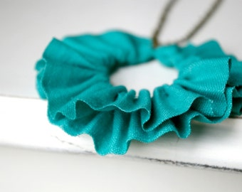 Linen ruffle necklace in seafoam green.