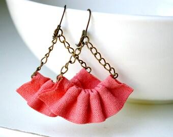 Linen ruffle earrings in coral.