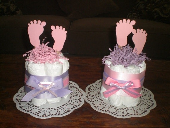 Baby feet diaper cake baby shower by bearbottomdiapercakes for Baby diaper decoration ideas